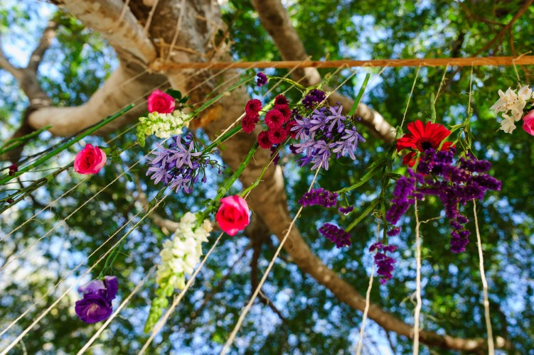 ceremony flowers hung vertically from tree