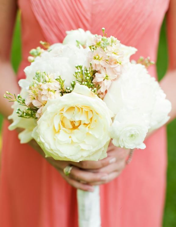 Peach bridesmaids wedding dress with white bouquet