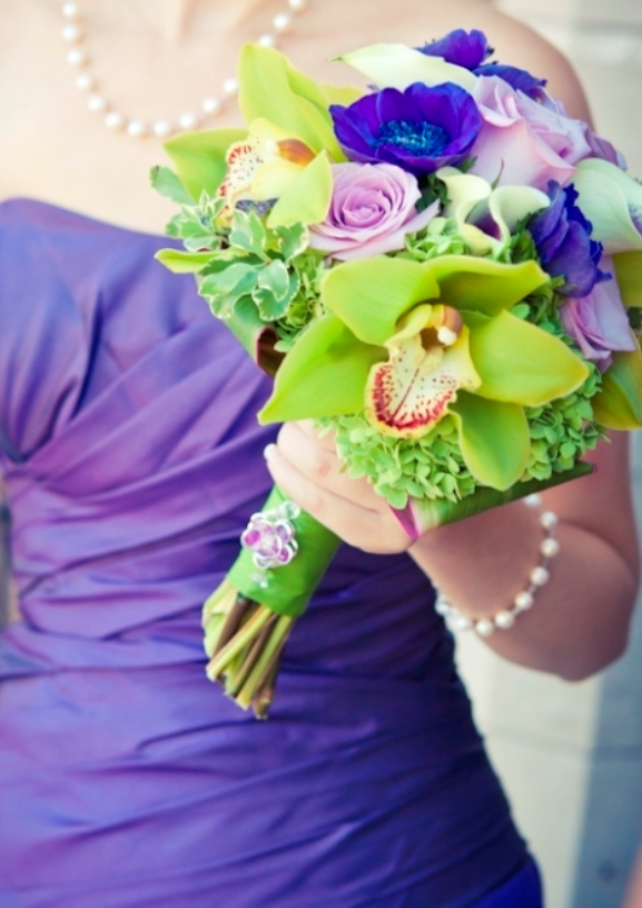 Purple bridesmaids dress with green purple orchids bridesmaids bouquet