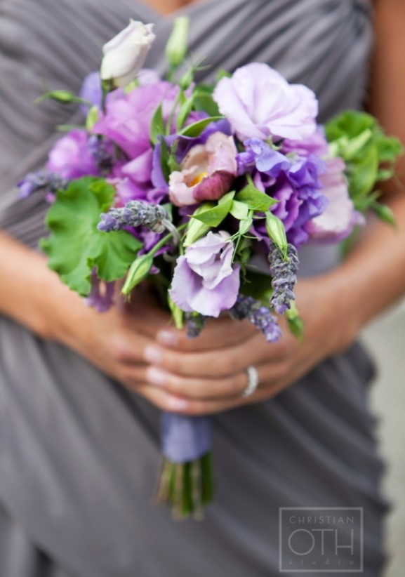 Silver bridesmaids dress with purple and lavender bridesmaids bouquet
