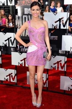 Victoria Justice in Versace with an Edie Parker clutch and Brian Atwood heels