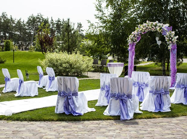 chair covers at wedding reception silver uk rentals - taylor rental arches tents