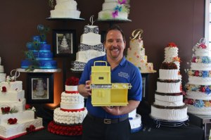 Wedding Wonderland Cakeshop owner, Michael Temm, holding his very first Easy Bake Oven.