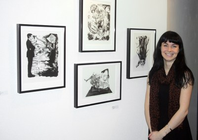 """Artist Katie O'Brien with her lithographs from the series """"Speaks""""."""