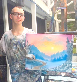 Justus Apruzzese with one of his beautiful paintings
