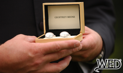 wedding ceremony groom holding geoffrey beene cuff links in a wooden box and Wedding Entertainment Director® logo