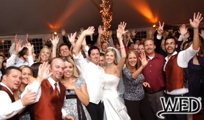 wedding reception bride, groom, and guests waving to the camera after the last dance and Wedding Entertainment Director® logo