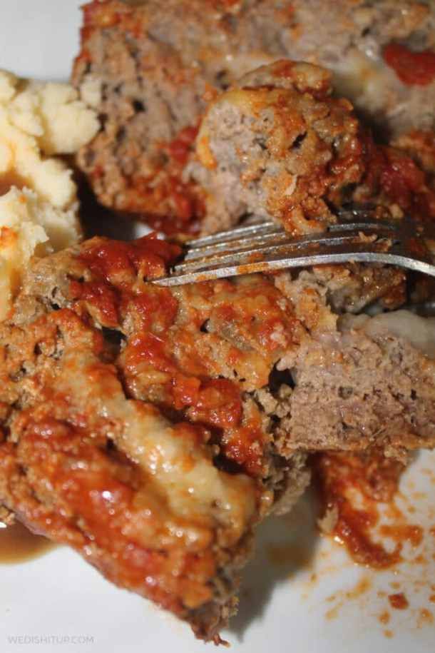 amazing stuffed meatloaf with fork