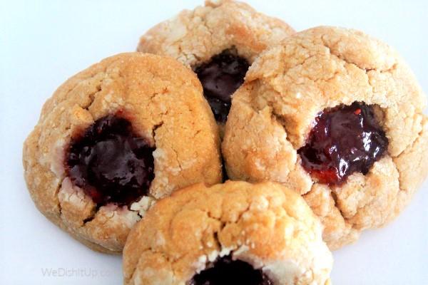 4 pb&j cookies on plate