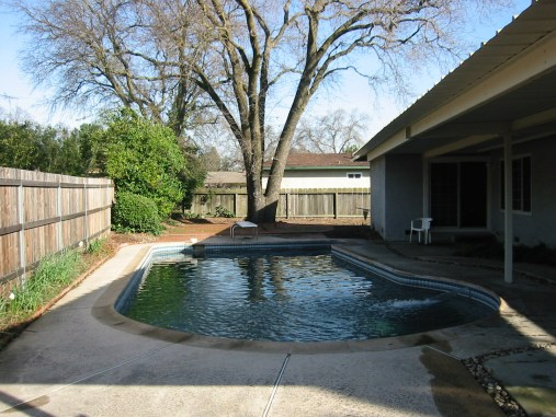 The covered patio prevents the pool from having afternoon sun