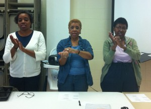 Lois Holmes, Viola Blouin and GloriaDean Harlan demonstrate a fingerplay