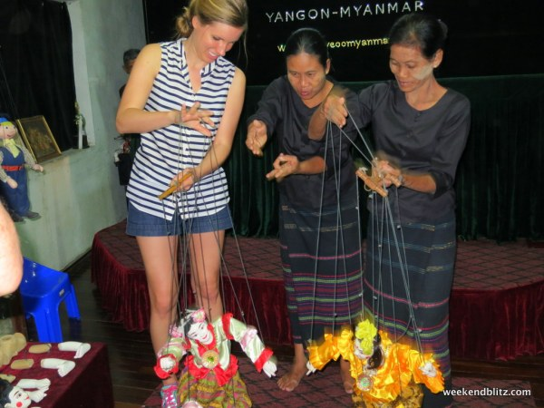 Our visit to Htwe Oo Myanmar, a puppet show housed in the house of a Burmese family, ended in my learning how to be a puppeteer, too!