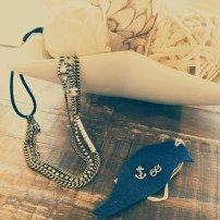 Crystal + Chain Stands Stretch Headband $58Maritime Knot + Anchor Studs $22