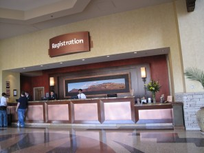 Registration desk with a mural of the Sandias.