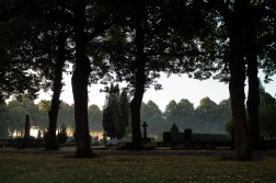 Mist rising from the ground in the churchyard.