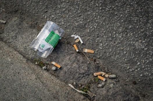 Trash swept onto the street.