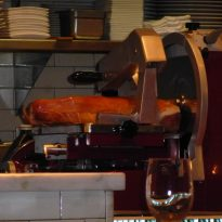 Gigantic slab of meat in the kitchen area of Revolucion Restaurant.