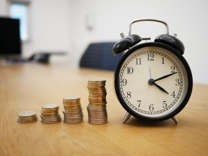 coins and a clock dishing 4 actionable tips on how not to get broke