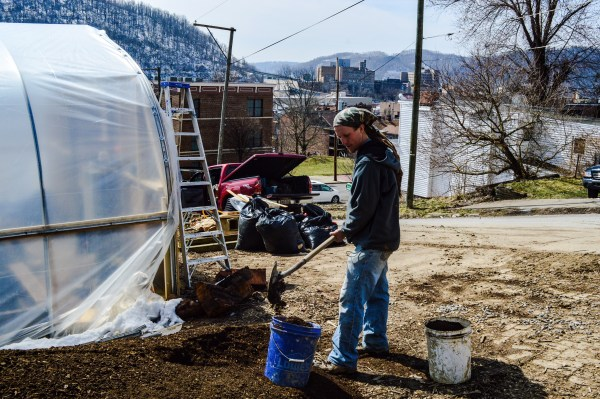 Danny Swan works to prepare top soil for the initiation of this year's growing season at Grow Ohio Valley's new greenhouse complex in East Wheeling.