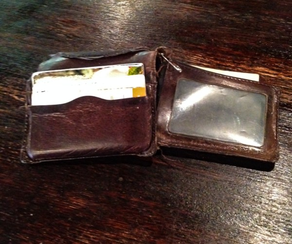 Scatterday's wallet, complete with a safety pin to keep it together.