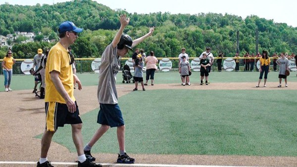 Miracle Leaguer Jamie Gallaher heads home during Opening Day 2013.