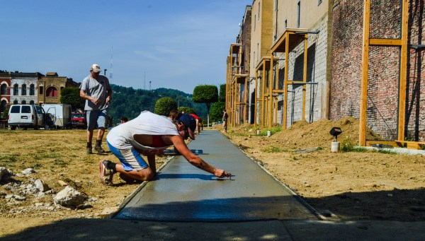 The sidewalk between Market and Main streets was being installed on Tuesday.