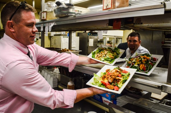 Doug Schmidt, husband of co-owner Becky Schmidtt, helps Miller and staff with a lunch service this week.