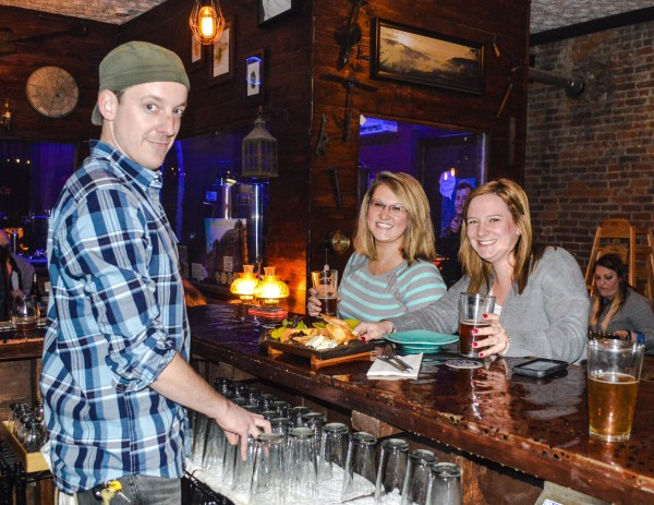 Barkeep Brenden Cupp and customers Abbey Bennett and Caroline McCabe, both of whom are residents of Martins Ferry, Ohio.