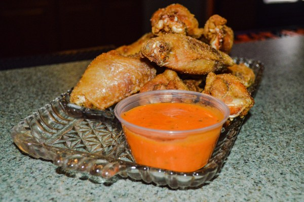 "Ozzie's five-spice wings with a side of ""Ozzied Sauce."""