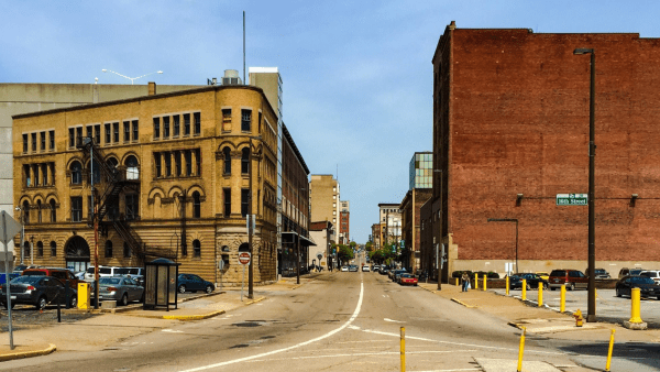 The Flatiron Building (on left) is located near the intersection of 16th and Main street.