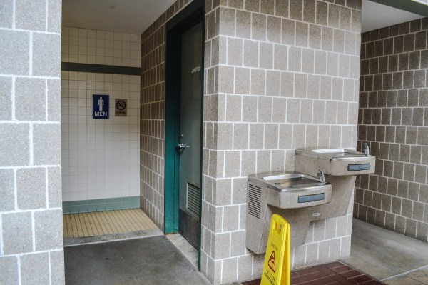 The empty portion of the garage's street level is equipped with restrooms.