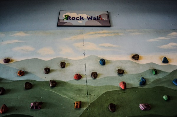The climbing wall is a popular attraction at the museum.
