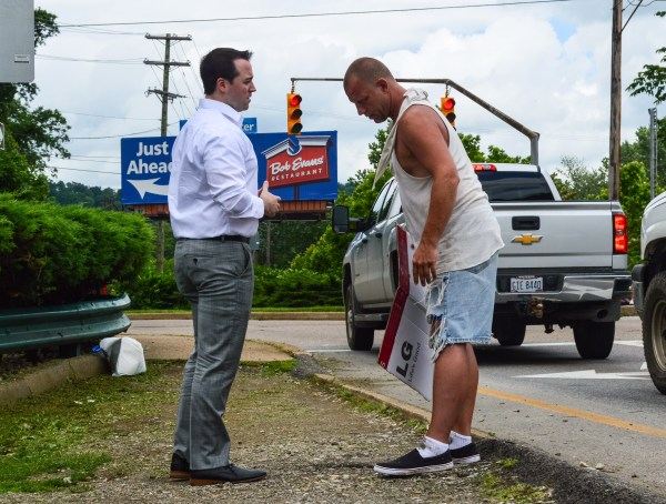 After being presented with concerns about panhandling in the Friendly City, W.Va. Del. Shawn Fluharty went to the intersection near Perkins Restaurant to speak with those soliciting donations.