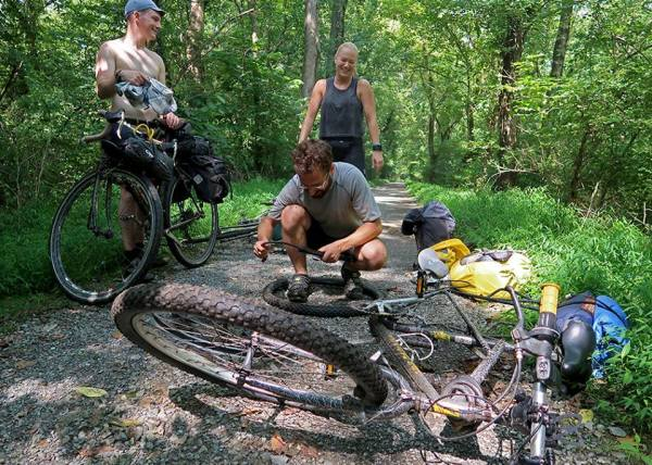 Koslik received some assistance from her new friends when her Timberline GT mountain bike blew a tire.