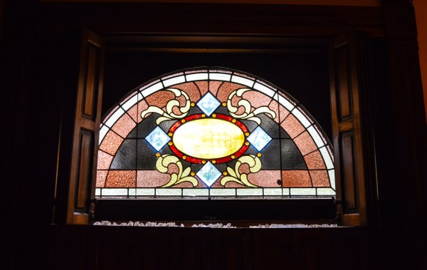 """The """"signature window,"""" according to Joe Figaretti, shines brightly inside a second-floor bedroom."""
