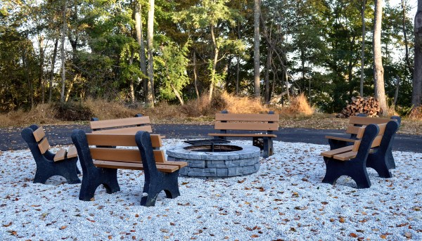 A community fire pit was installed for the occupants of the four treehouse cabins and Grand Vue Park supplies the wood.