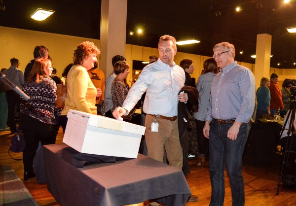 """Wil Turani, the director of operations and sustainability for Orrick in Wheeling, casts his vote during the """"Show of Hands"""" event in February."""