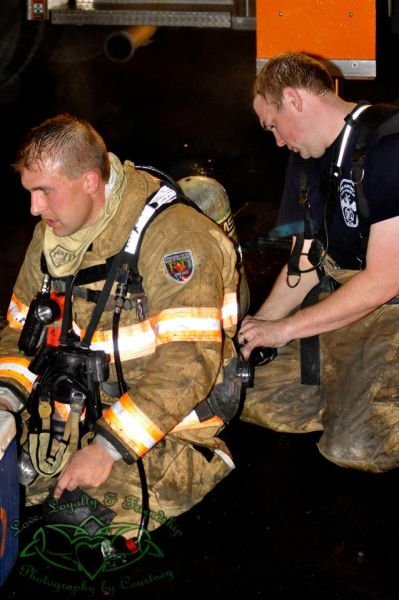 Harmon (left left) has been a Wheeling firefighter for 20 years.
