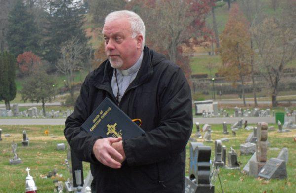Doug Breiding speaks at the OVMC skeleton burial service.