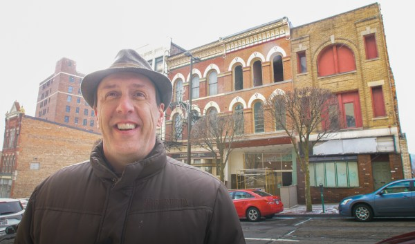 Gabe Hays standing in front of downtown buildings