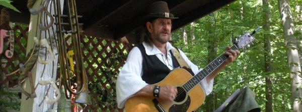Balladeer Terry Griffith playing guitar.