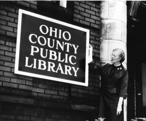 Librarian Virginia Ebeling in front of the Ohio County Public Library when it was located at 2100 Market St. building.