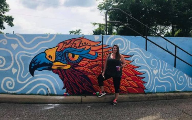 Local artist Mindi Yarbrough and the 2019 Orrick Pride in Wheeling Community Mural