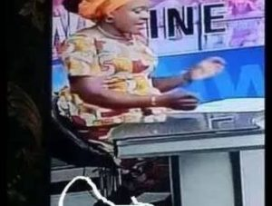 SHOCKING!! Leaked Photo Of NTA News Caster Wearing Sneakers On Native Attire Surfaced Online
