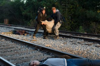 Michael Cudlitz as Abraham, Merritt Wever as Dr. Denise Cloyd, Josh McDermitt as Dr. Eugene Porter, and Norman Reedus as Daryl Dixon - The Walking Dead _ Season 6, Episode 14 - Photo Credit: Gene Page/AMC