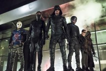 """Arrow -- """"So It Begins"""" -- Image AR506b_0067b.jpg -- Pictured (L-R): Rick Gonzalez as Rene Ramirez/Wild Dog, Echo Kellum as Curtis Holt/Mr.Terrific, Stephen Amell as Oliver Queen/The Green Arrow, David Ramsey as John Diggle/Spartan, Madison McLaughlin as Evelyn Sharp/Artemis, and Joe Dinicol as Rory Regan/Ragman -- Photo: Katie Yu/The CW -- © 2016 The CW Network, LLC. All Rights Reserved."""