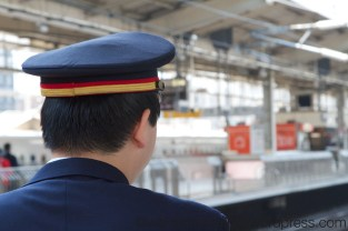 The smart uniformed attendant waits for the train