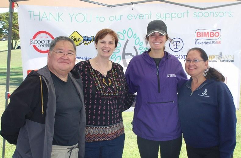 Ron Emedrana (from left), Jennifer Coxwell, Abby McAdory and Irene Emedrano welcome golfers on Oct. 1 for the Havenwood tournament in Bella Vista.  (NWA Democrat-Gazette/Carin Schoppmeyer)