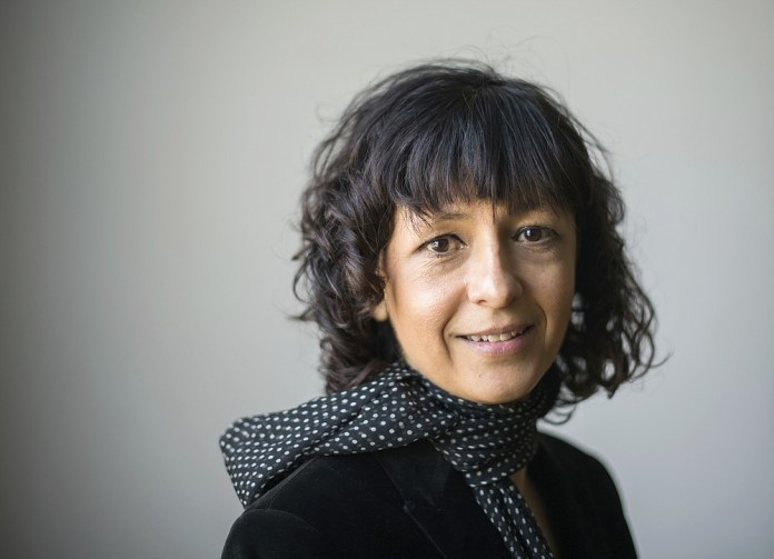FILE - In this file photo from March 14, 2016, French microbiologist Emmanuelle Charpentier poses for a photo in Frankfurt, Germany.  French scientist Emmanuelle Charpentier and American Jennifer A. Doudna won the 2020 Nobel Prize in chemistry for having developed a method of genome editing similar to `` molecular scissors '' that offers the promise of one day curing diseases genetic.  (Alexander Heinl / dpa via AP)
