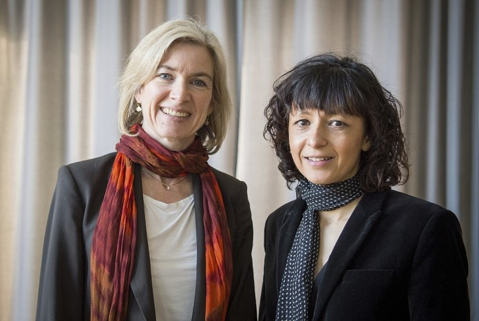 FILE - In this March 14, 2016 file photo, American biochemist Jennifer A. Doudna, left, and French microbiologist Emmanuelle Charpentier, right, pose for a photo in Frankfurt, Germany.  French scientist Emmanuelle Charpentier and American Jennifer A. Doudna won the 2020 Nobel Prize in chemistry for having developed a method of genome editing similar to `` molecular scissors '' that offers the promise of one day curing diseases genetics.  (Alexander Heinl / dpa via AP)